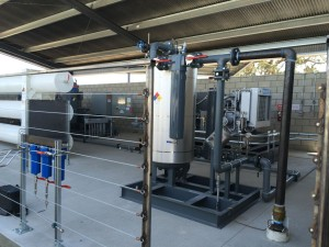 The guts of the new Revolution CNG station for 3G CNG in Paso Robles: note Bauer C-25.0 compressor at rear.